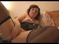 Leader mature babe highly strips nearly to stockings and garter stra