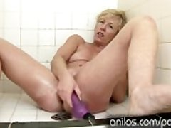 The brush own cum dripping from her mature pussy