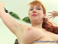 British milf Red strips off together with finger fucks